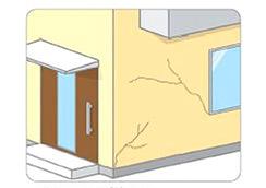 外壁の表面にヒビがはいる。